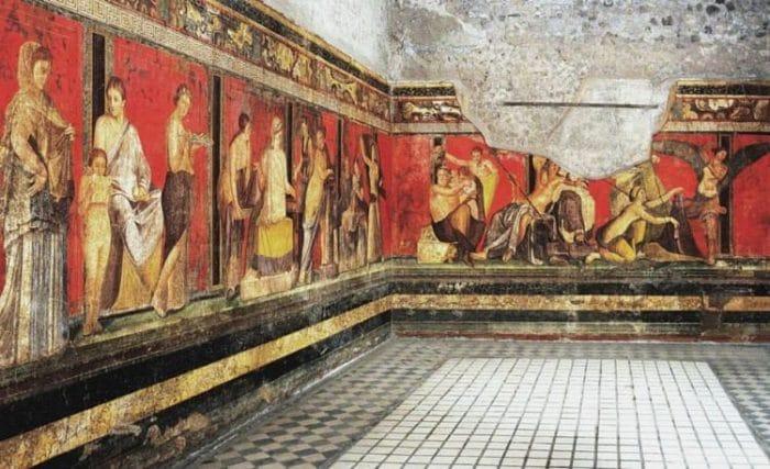 Parte del fresco que se encuentra en Villa Dei Misteri mostrando la iniciación de una mujer en el culto de Dionisio